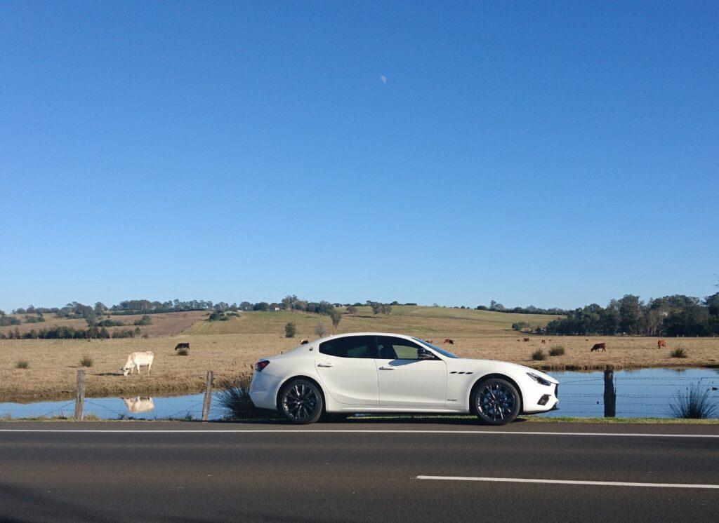 Maserati Ghibli Hybrid with rural view